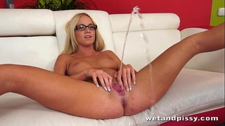 Pretty golden-haired in glasses uses a jelly marital-device on her juicy wet crack to agonorgasmos