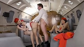 Hot initiation foursome with three sexy stewardesses fuck on private plane in uniform