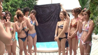 Group of beautiful Asian girls having fun by the pool